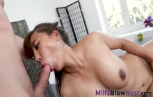 Asian milf sucking and stroking cock