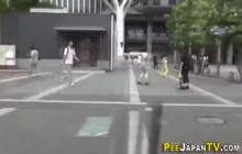 Asian leaves piss puddle in public street